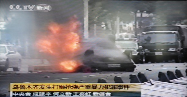 Uighurs Overturn Police Car And Set It Ablaze In PRC