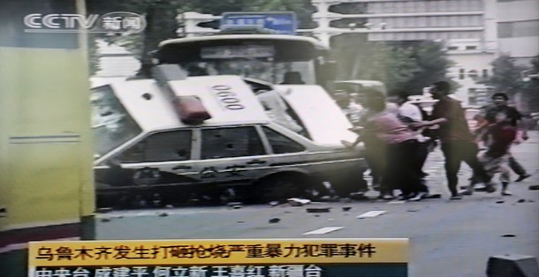 Uighurs Overturning Police Car In PRC