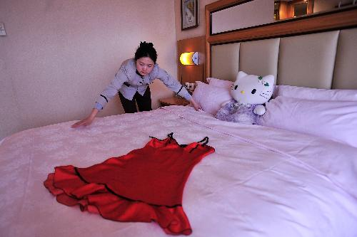 Hello Kitty Hotel In California. A hotel maid makes a bed in a