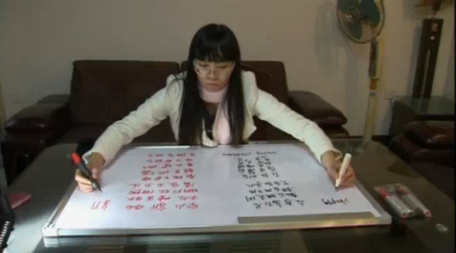 Woman Writes Chinese & English Characters Simultaneously
