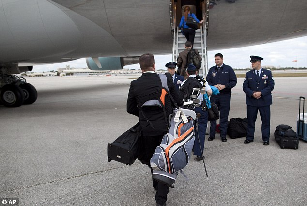 White House Aide Boarding Air Force One with Golfing Equipment