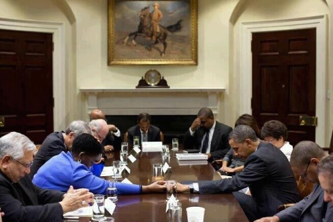 Obama & Cabinet Praying Hurricane Sandy