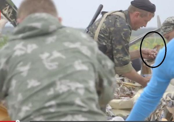 Caught in the Act Looting Ring from MH 17 Victim