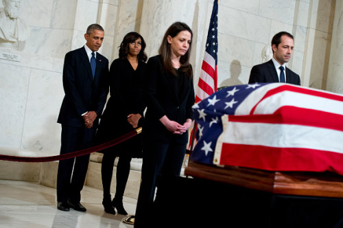UNITED STATES - FEBRUARY 19: President Barack Obama and First Lady Michelle Obama pay respects to the late Justice Antonin Scalia as he lies in repose in the Supreme Court, February 19, 2016, ahead of his burial tomorrow. Former law clerks also appear near the casket.(Photo By Tom Williams/CQ Roll Call)